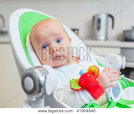 baby clutched colorful toy