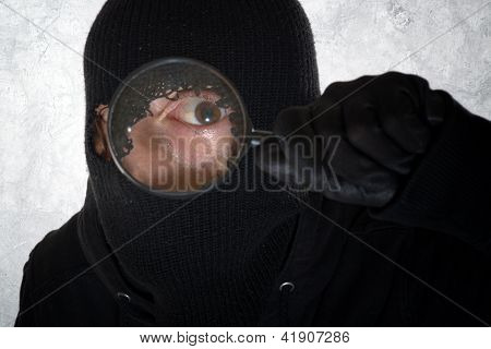Burglar With Magnifying Glass