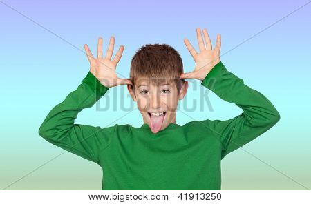 Funny child mocking isolated on blue and green background