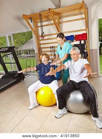 Senior people doing rehab gymnastics on gym balls