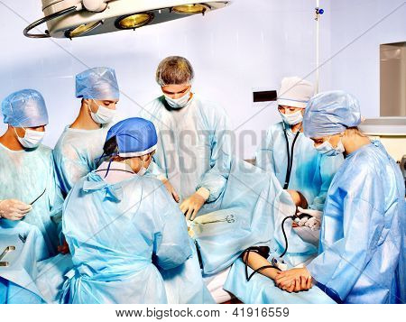 Group of people surgeon in operating room.