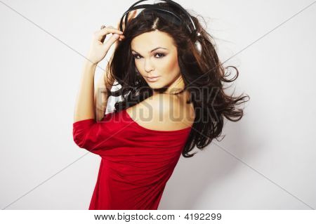 Young Beautiful Happy Women Listening Music In Headphones