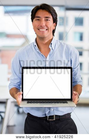 Business man showing something on a laptop screen