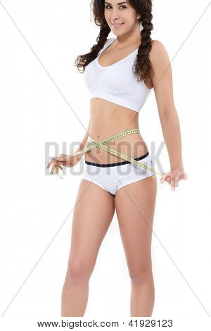 Young attractive woman in underwear with measuring tape and perfect body over white background