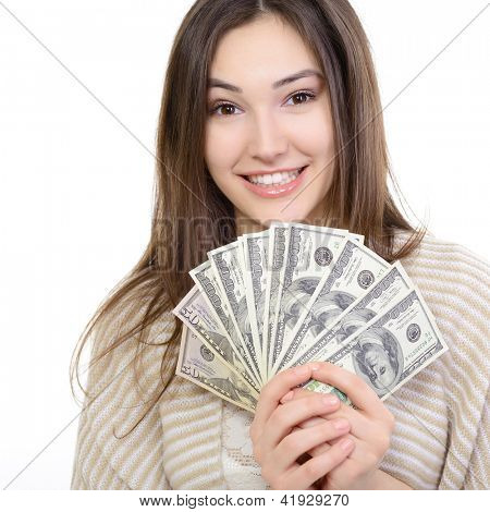 Cheerful attractive young lady holding cash and happy smiling over white