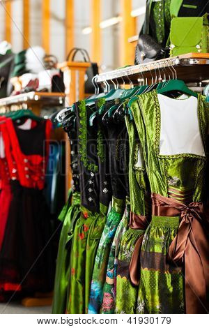 Traditional clothes - Tracht or dirndl hanging in a retail shop or boutique
