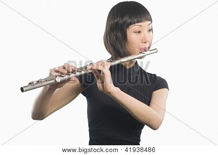 Beautiful woman playing flute isolated over white background