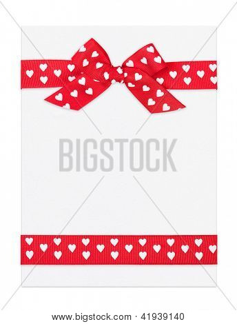 blank paper sheet with red bow and ribbon