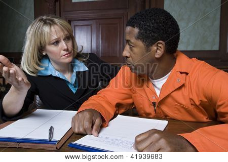 Female advocate in conversation with prisoner