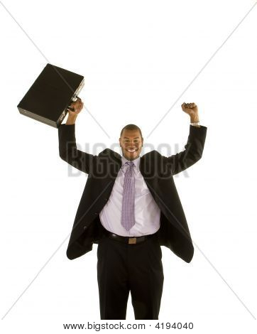 Black Man Holding Up Briefcase And Raising Fist