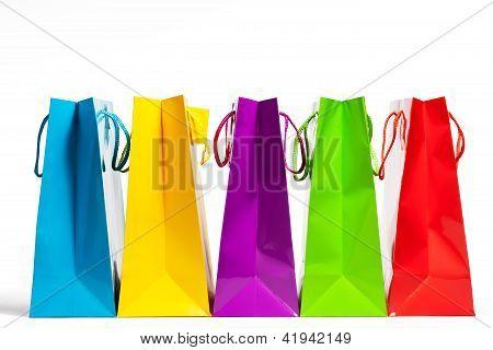 four shopping bags in a row