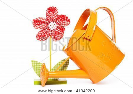 red easter drape flower with a orange watering can