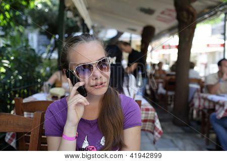 Teen Speaking By Phone