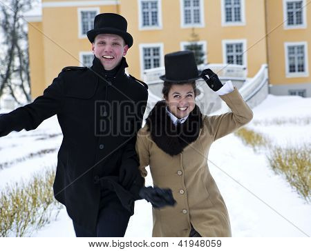 Man And Woman Greeting Happily Coming Guests