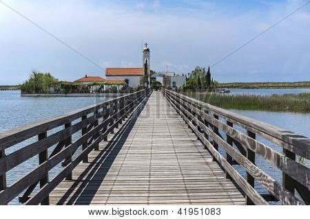 Old Wooden Bridge On A Canal