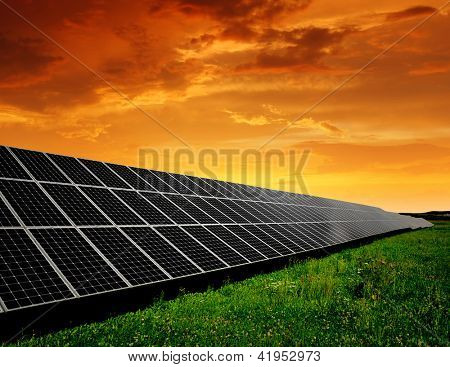 Solar energy panels in the setting sun