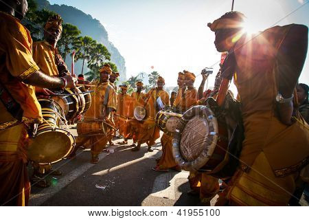 KUALA LUMPUR - JANUARY 27: Urumi melam drums brigade accompany the Hindu devotees in their procession to the Batu Caves temple on January 27, 2013 at the Thaipusam festival in Kuala Lumpur, Malaysia.