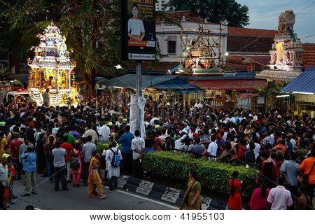 KUALA LUMPUR - JANUARY 26: Hindu devotees come to the Sri Thandayuthapani Temple in Kuala Lumpur, Malaysia to pray to Lord Muruga on January 26, 2013 during the annual Thaipusam festival.