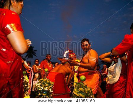 KUALA LUMPUR - JANUARY 27: A Hindu priest prays and blesses devotees before their procession to the Batu Caves temple on January 27, 2013 during the Thaipusam festival in Kuala Lumpur, Malaysia.