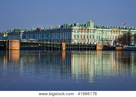 View Winter Palace in Saint Petersburg with reflection from Neva river. Russia .