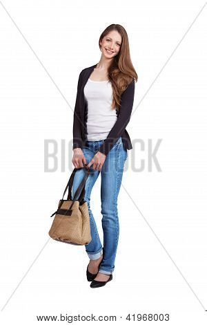 Young Woman In Blue Jeans And Pullover