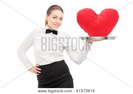 A waitress with bow tie holding a tray with red heart on it tray isolated on white background