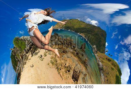 Girl jumping on Exotic Bay in Phuket island Thailand