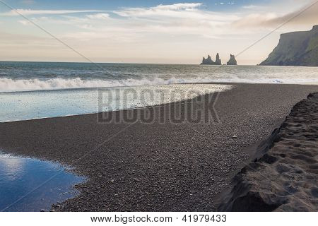 Black Beach In Background Dyrholaey - Vik, Iceland.