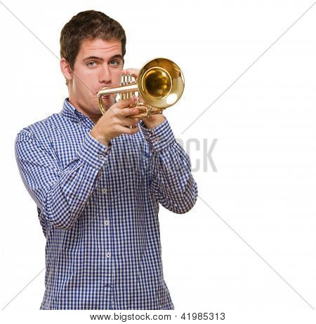 Young Man Blowing Trumpet On White Background