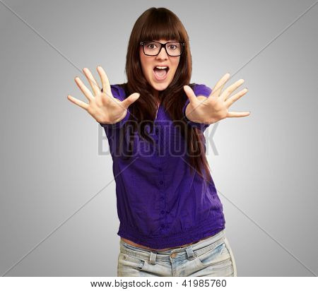 Woman Stopping With Hands Isolated On Gray Background
