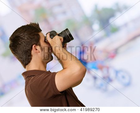 Portrait Of Young Man Capturing Photo, Outdoor
