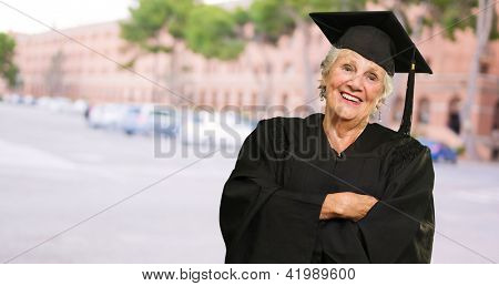 Senior Graduate Woman With Hands Folded, Outdoors