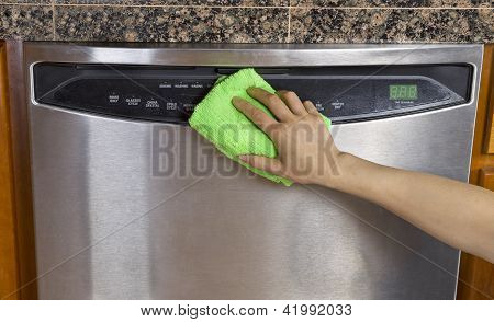 Wiping Clean Dishwasher With Microfiber Rag