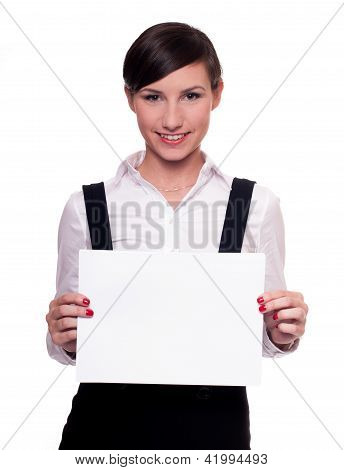 Pretty businesswoman with blank piece of paper