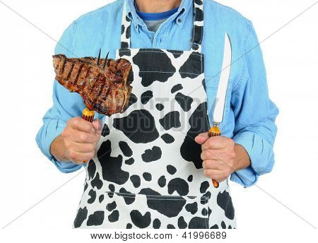 Closeup of a man holding a fork with a barbecued t-bone steak. Man is unrecognizable isolated on a white background.