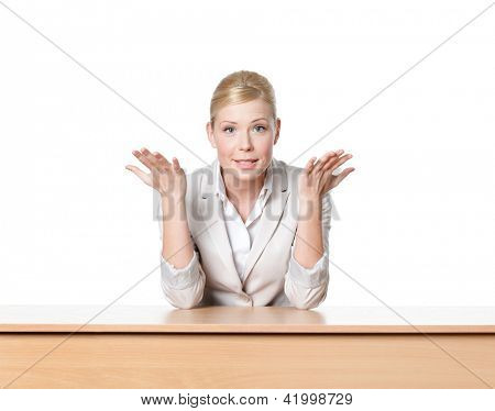 Young businesswoman sitting at a office desk, isolated