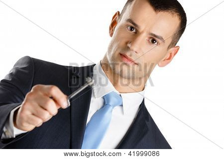 Businessman shows key, isolated on white. Real estate concept and successful bargain