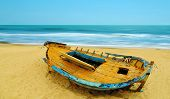 image of deserted island  - Deserted boat on a beach in Hammamet Tunisia - JPG