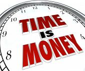The saying or quote Time is Money on a white clock to symbolize the value and fleeting nature of tim