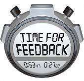 stock photo of soliciting  - A stopwatch timer shows the words Time for Feedback soliciting opinions - JPG