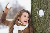 picture of snowball-fight  - Happy young woman playing in snowball fights - JPG