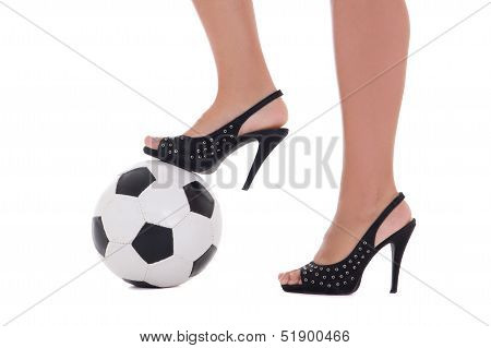 Sexy Woman Feet With High Heels And Soccer Ball On White Background