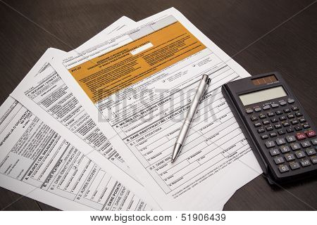 Polish Tax Form With Pen And Calculator On Desk