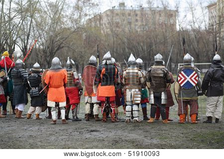 MOSCOW - APRIL 28: Backs of soldiers at Battle of East - Russia-Orda XI-XV centuries on Maneuvers East versus West, on April 28, 2013 in Moscow, Russia.  Organizer of event - Paladin fencing center.