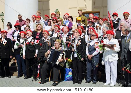 MOSCOW - MAY 9: Sad veterans sing near Bolshoi theater, on May 9, 2013 in Moscow, Russia.  Every year on square in front of Bolshoi Theater traditionally gather veterans of Great Patriotic War.