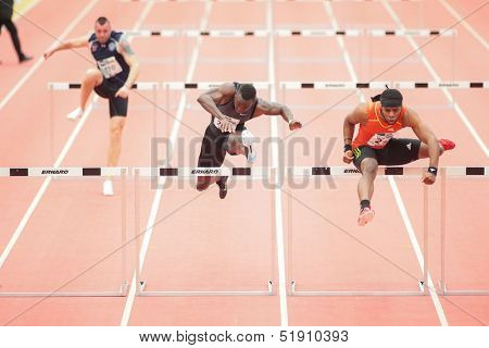 LINZ, AUSTRIA - JANUARY 31 Omo Osaghae (#212 USA) wins the men's 60m hurdles special event on January 31, 2013 in Linz, Austria.