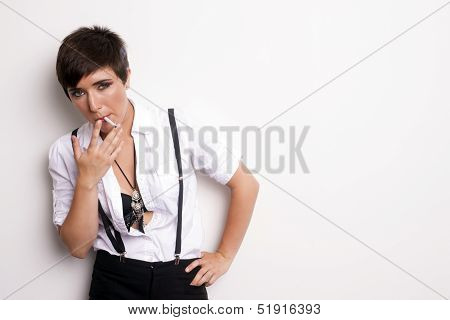 Young Androgynous Addicted Person Stands Smoking Cigarette White Background