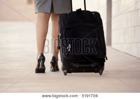 Woman With Roller Bag