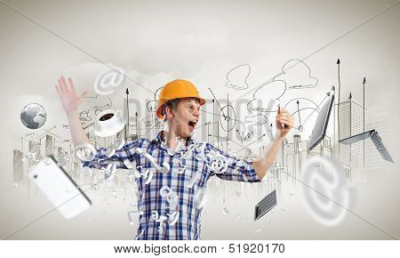 Image of young man engineer screaming angrily in mobile phone