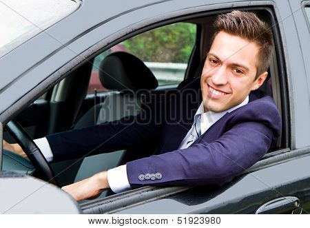 an happy smiling man in his new car